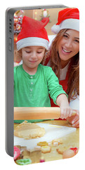 Mother With Son Doing Christmas Cookies Portable Battery Charger