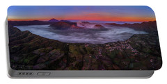 Portable Battery Charger featuring the photograph Mount Bromo Misty Sunrise by Pradeep Raja Prints