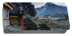 Portable Battery Charger featuring the photograph Namche Monastery Morning Sunrays by Mike Reid