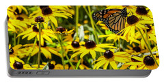 Monarch Butterfly On Yellow Flowers Portable Battery Charger