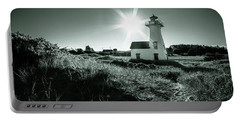 Portable Battery Charger featuring the photograph New London Light Behind Dunes by Chris Bordeleau