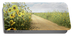 Portable Battery Charger featuring the photograph New Mexico Sunflower Road by Andrea Hazel Ihlefeld