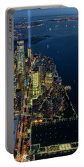 Portable Battery Charger featuring the photograph New York City Remembers 911 by Susan Candelario