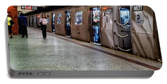 Portable Battery Charger featuring the photograph New York City Subway Stare by Lars Lentz