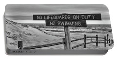 Portable Battery Charger featuring the photograph No Lifeguards On Duty Black And White by Paul Ward