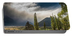 Portable Battery Charger featuring the photograph North Of Glenorchy by Gary Eason