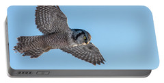 Portable Battery Charger featuring the photograph Northern Hawk Owl Hunting by Mircea Costina Photography