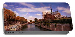 Portable Battery Charger featuring the photograph Notre Dame Cathedral And The River Seine - Paris by Barry O Carroll