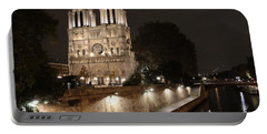 Portable Battery Charger featuring the photograph Notre Dame Cathedral From Petit Pont by Christopher Kirby