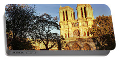 Portable Battery Charger featuring the photograph Notre Dame De Paris Facade by Barry O Carroll