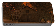 Notre Dame Log Chapel Winter Night Portable Battery Charger by John Stephens