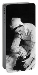 Nurse Tending To A Patient Portable Battery Charger