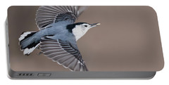 Portable Battery Charger featuring the photograph Nuthatch In Flight by Mircea Costina Photography