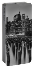 Portable Battery Charger featuring the photograph Nyc Skyline Bw by Laura Fasulo