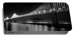 Portable Battery Charger featuring the photograph Oakland Bay Bridge At Night by Darcy Michaelchuk