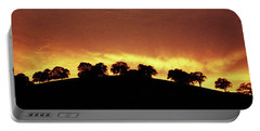 Portable Battery Charger featuring the photograph Oaks On Hill At Sunset by Jim and Emily Bush