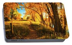 Portable Battery Charger featuring the photograph October's Light by John De Bord
