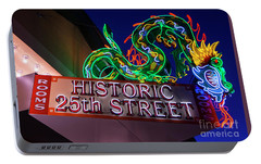 Portable Battery Charger featuring the photograph Ogden's Historic 25th Street Neon Dragon Sign by Gary Whitton