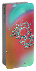 Portable Battery Charger featuring the digital art Oil And Water by Kevin Blackburn