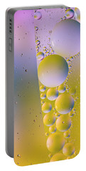Portable Battery Charger featuring the photograph Oil In Water by Kevin Blackburn
