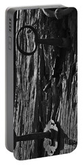 Old And Abandoned Wooden Door With Skeleton Keys Portable Battery Charger
