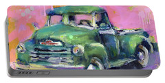 Old Chevy Chevrolet Pickup Truck On A Street Portable Battery Charger