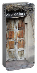 Portable Battery Charger featuring the photograph Old Gallery Door by Andrea Hazel Ihlefeld