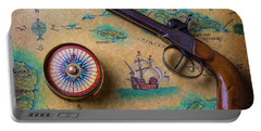 Old Gun And Compass On Map Portable Battery Charger