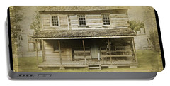Portable Battery Charger featuring the photograph Old Log Cabin by Joan Reese