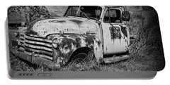 Portable Battery Charger featuring the photograph Old Rusty Chevy In Black And White by Paul Ward