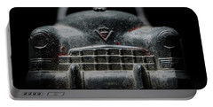 Portable Battery Charger featuring the photograph Old Silver Cadillac Toy Car With Specks Of Red Paint by Art Whitton