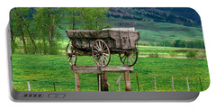 Old Time Freight Wagon In Montana Portable Battery Charger by Wernher Krutein