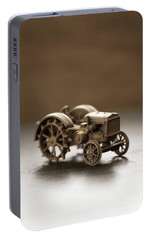 Portable Battery Charger featuring the photograph Old Toy Tractor by Edward Fielding