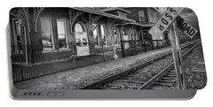 Old Train Station With Crossing Sign In Black And White Portable Battery Charger
