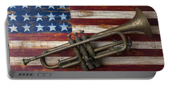 Old Trumpet On American Flag Portable Battery Charger