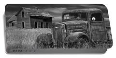 Old Vintage Pickup In Black And White By An Abandoned Farm House Portable Battery Charger