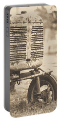 Portable Battery Charger featuring the photograph Old Vintage Tractor Brown Toned by Edward Fielding