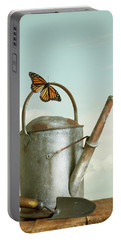 Old Watering Can With A Butterfly Portable Battery Charger