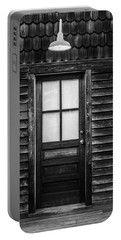 Portable Battery Charger featuring the photograph Old Wood Door And Light Black And White by Terry DeLuco