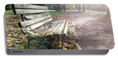 Rustic Wooden Bench During Late Autumn Season On Bright Day Portable Battery Charger