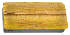 Old Yellow Paint On Wood Portable Battery Charger by John Williams