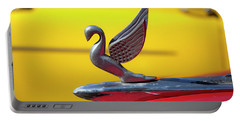 Portable Battery Charger featuring the photograph Oldsmobile Packard Hood Ornament Havana Cuba by Charles Harden
