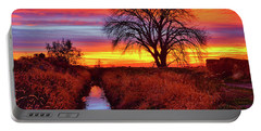 Portable Battery Charger featuring the photograph On The Horizon by Greg Norrell