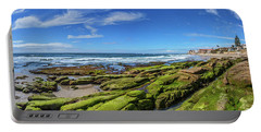 Portable Battery Charger featuring the photograph On The Rocky Coast by Peter Tellone