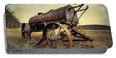 Portable Battery Charger featuring the photograph On The Water Wagon - Agricultural Relic by Gary Heller