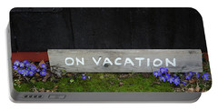 Portable Battery Charger featuring the photograph On Vacation Sign By Blue Flowers by Kennerth and Birgitta Kullman