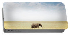 One Elephant Walking In Grass In Africa Portable Battery Charger