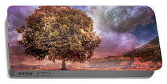 Portable Battery Charger featuring the photograph One Tree In The Meadow by Debra and Dave Vanderlaan