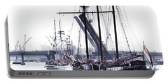 Portable Battery Charger featuring the photograph Oosterschelde Leaving Port by Stephen Mitchell