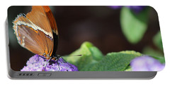Orange And Brown Butterfly On Purple Portable Battery Charger